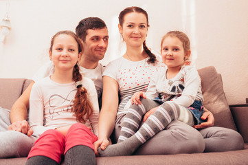 Happy family at home on the couch