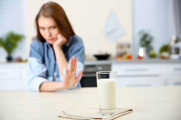 Glass of milk and woman on background