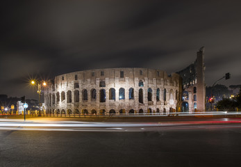 night lights and car trails in front of Colosseo in Rome in Italy