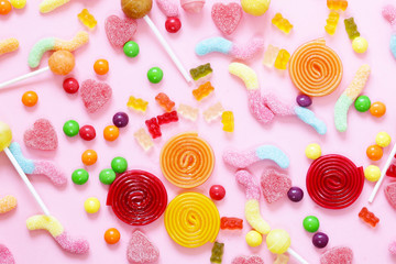 Colorful candy and fruit jelly jujube on a pink background