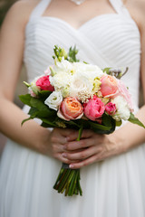 Tender bouquet of roses in Bride's hands