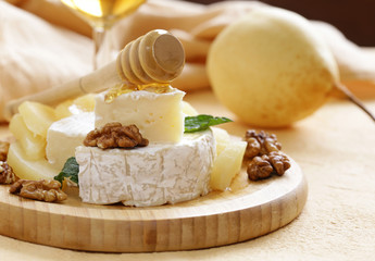 Organic camembert cheese with nuts and pears