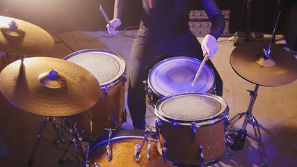 Night club music - sensual dashing girl percussion drummer perform rock