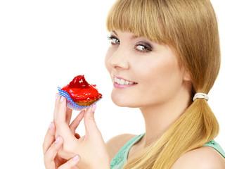 Woman holds cake strawberry cupcake