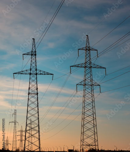 """high-voltage power lines at sunset. electricity ..."
