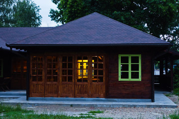 Little wooden cabin with a green window at blue hour in Belgrade, Serbia