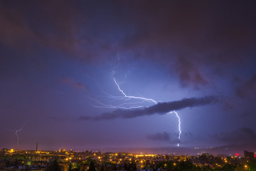 storm at night over the city (lightning bolt)