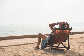 Senior man enjoy his vacation after retirement take sunbath on beach chair