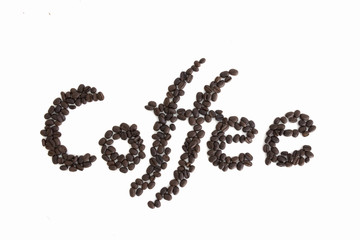 The word Coffee spelled with hundreds of coffee beans. Isolated against white background