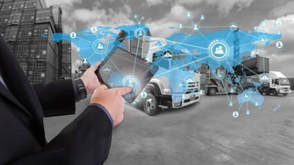 hand presses on world map with social media,Truck with Industrial Container Cargo for Logistic Import Export at yard (Elements of this image furnished by NASA)