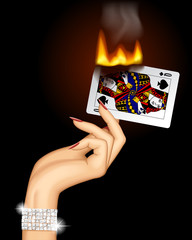 Hand with a burning playing card