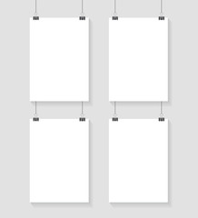 Vector template of 4 poster on clips . Vertical blank A4 mockup banner