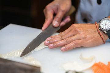 chef making  sashimi  in the kitchen