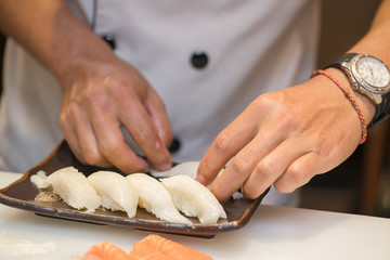 chef making  sushi in the kitchen