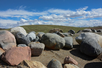 Rocks and Boulders on Hill with Blue Sky