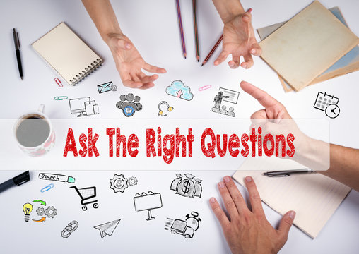 Ask The Right Questions concept. The meeting at the white office table.
