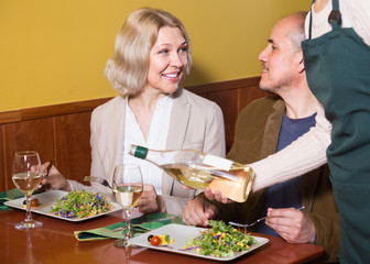 Positive  mature couple having dinner at restaurant