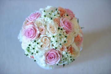 Bridal flower arrangement with pink and cyclamen roses and white garden  small flowers