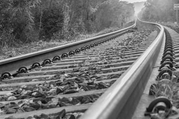 The train runs along the railroad tracks to infinity