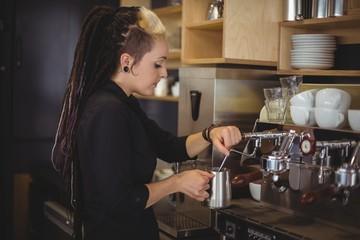 Waitress using the coffee machine