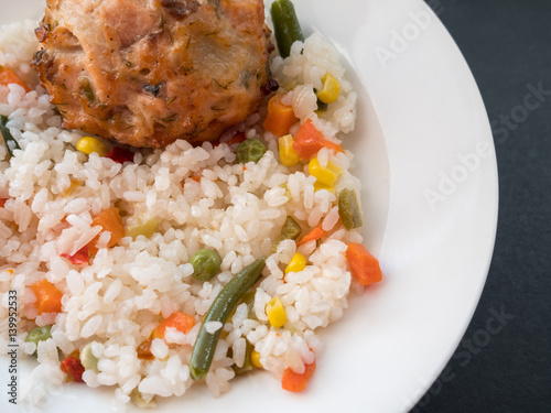 Fish cutlet with a side dish of rice on dark background for Rice side dishes for fish