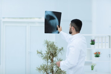 medical doctor looking at x-ray picture in hospital