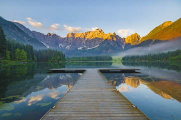 Wall Mural - sunrise over the crystal-clear mountain lake in the Julian Alps