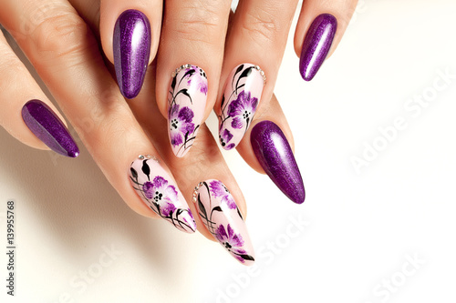 Nail Art Service Female Manicure And Floral Patterns Stock Photo