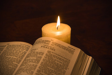 Open Bible and Candle