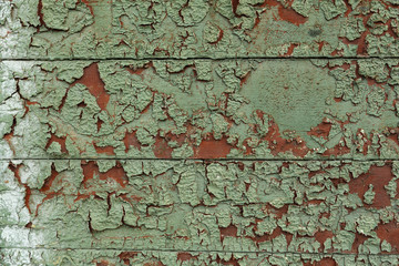 old paint on a wooden surface