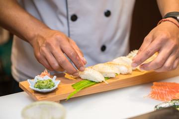 chef  preparing sushi in the restaurant kitchen