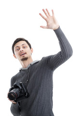 young professional photographer with digital camera waving Hello