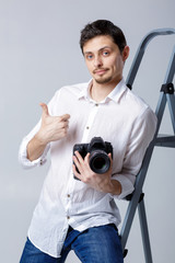 successful professional photographer use DSLR digital camera on