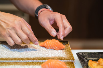 chef  preparing sushi in the restaurant kitchen