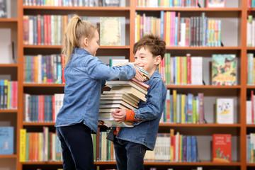schoolboy and schoolgirl in the library