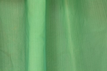 A light green background in the abstract.