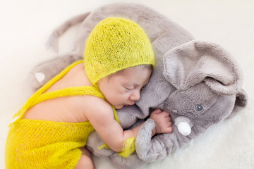 Newborn Baby Girl Wearing a Yellow Hat
