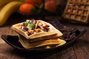 Delicious waffles with banana and chocolate