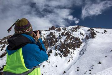 Nature Photography Concept. Professional photographer takes photos of rock peak. Winter landscape.