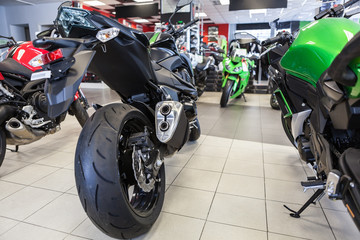 Naked motorbikes standing in show room at sale. Motorcycle store