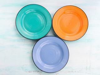 Pastel Color ceramic turquoise, orange, blue plate dish top view background