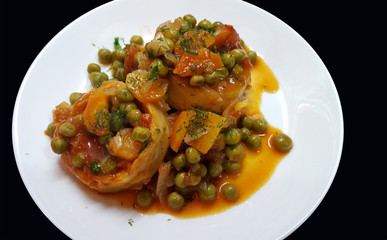 Cooked Artichoke with green peas and carrots