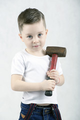 Child builder model with a large hammer in white
