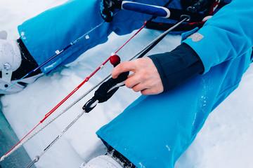 Snowkiting. Male athlete skier snowboarder manages kite. Close-up. The Kola Peninsula.