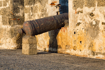 Detailed view of a cannon in the caribbean sunset in Cartagena, Colombia.