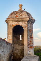 Birds perch on a turret built in the colonial era wall that protected Cartagena, Colombia during the colonial era.