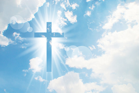 Christian cross appears bright in the sky background