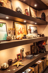 Interior design shelves with travel souvenirs and accessories in nautical vintage style with illumination