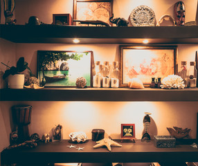 Interior vintage style wall shelves with travel nautical decoration souvenirs and accessories