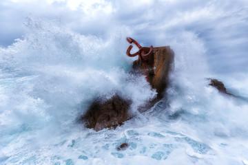 Waves splashing in El peine de los vientos, Chillida's sculpture sited in Donostia, Spain, on March 2017